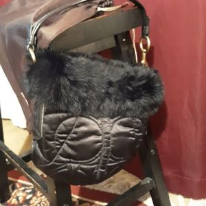 Black snowbunny coach shoulder bag